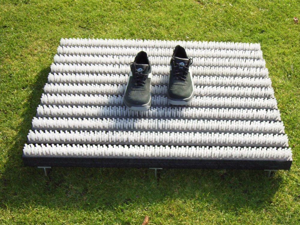 Borstelmat gras schoenen vegen